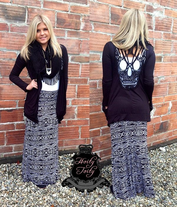 Maxi skirts are a great way to stay trendy and comfy in fall ! Pair our black and white Aztec maxi skirt with our NEW skull back cardigan . Get the look at Hoity Toity