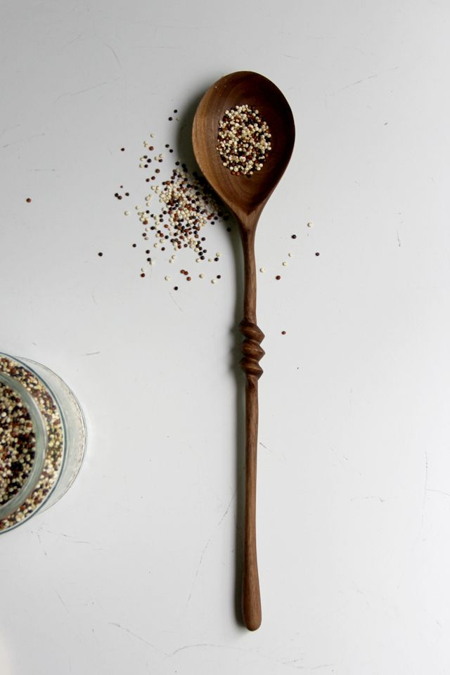 Hand carved walnut serving spoon with spiral detail by Ariele Alasko