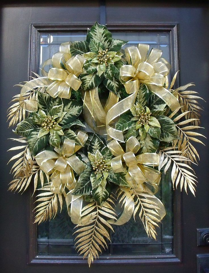Glistening palms, glamorous bows & velvety poinsettias are a beautiful combination in shades of green & gold.