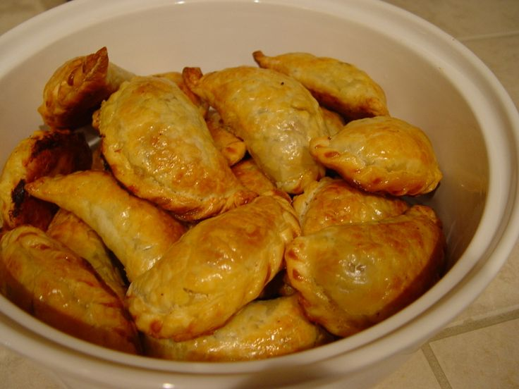 Argentine Empanadas. This is the most authentic recipe for empanadas online. I was starting to think I'd have to write up my own. This recipe is time consuming but well worth the outcome. Please note that I add sweet Hungarian paprika to the filling as its one of the key ingredients which was omitted. I don't add olives because I personally don't like them but feel free to do so. Enjoy!