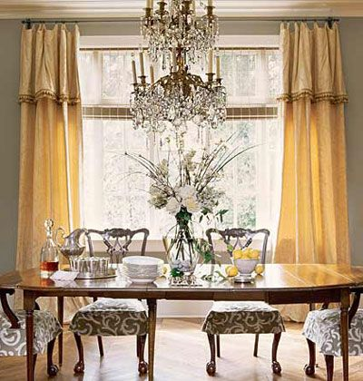 3 A Dining Room With Yellow Curtains Love The Gray Accent Color Chair