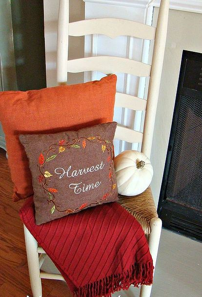 our fall mantel, seasonal holiday decor, Was happy to have spotted this cute ladderback chair recently at a consignment shop for only 10 It serves as a great spot for a couple of seasonal pillows pumpkin and throw