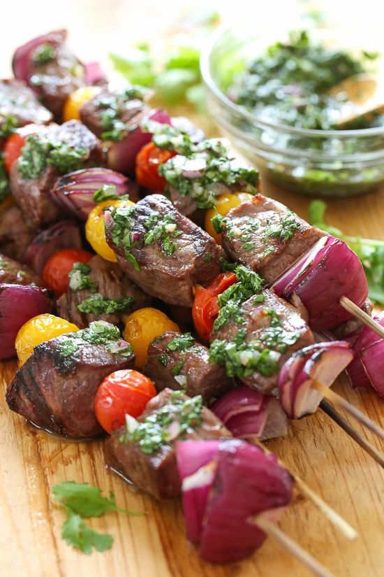Steak Kebabs with Chimichurri 1 1/4 pounds beef, (sirloin or Angus) cut into 1-inch cubes fresh ground pepper 1 1/4 tsp kosher salt 1 large red onion, cut into large chunks 18 cherry tomatoes 6 bamboo skewers, soaked in water for 1 hour FOR THE CHIMICHURRI SAUCE:  2 packed tbsp parsley, finely chopped (no stems) 2 packed tbsp chopped cilantro 2 tbsp red onion, finely chopped 1 clove garlic, minced 2 tbsp extra virgin olive oil 2 tbsp apple cider vinegar 1 tbsp water 1/4 tsp koshe