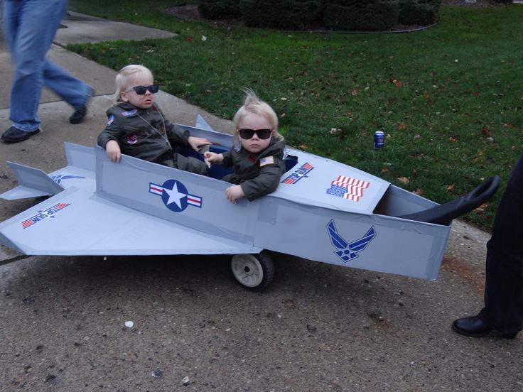 The boys halloween costume 2012 wagon transformed into a fighter jet with my twins Maverick and Goose