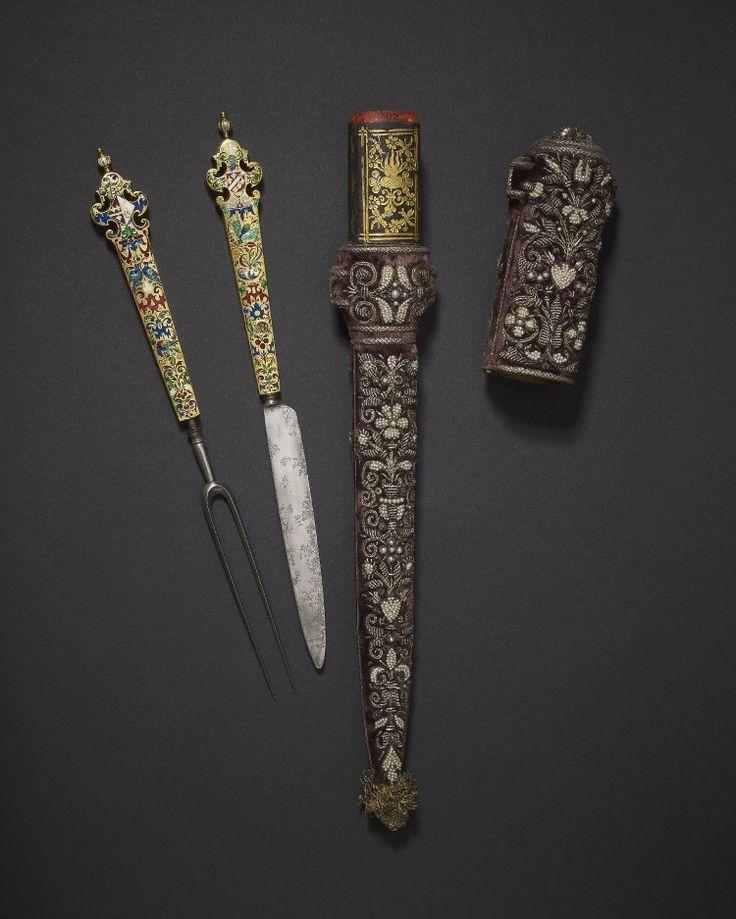 Netherlands, ca 1600. Wedding knife and fork; gold enamelled handles; purple velvet sheath embroidered with gold thread and seed pearls; knife handle engraved on one side and filled with enamel, scrolls, birds and insects; ship on top with flag of Holland; other face similar b