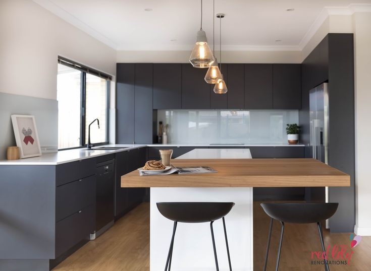 Red Lily Renovations - Perth. Grey Vinyl Wrap Doors.  Pure White Caesarstone benchtop.  Vic Ash real wood breakfast bar.  Glass splashback. Beacon lighting Ando 1 Light Pendant in Concrete/Glass.  ABEY pullout tap in Matt Black TIMKD-B