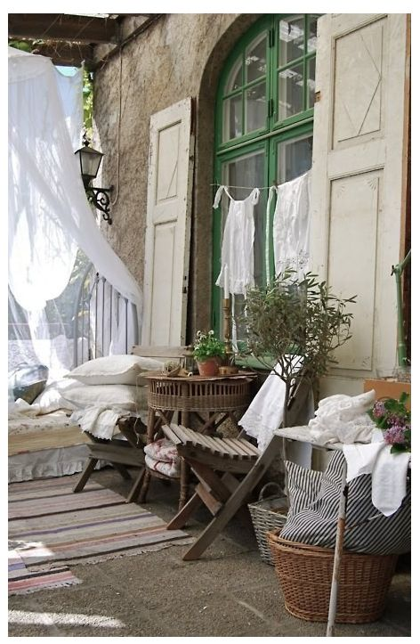 Neutral porch with clothes drying and summer green window.