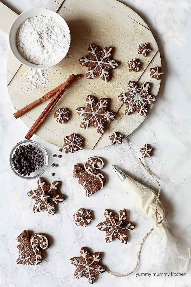 Gingerbread Cookies Cut Out Into Shapes And Decorated With
