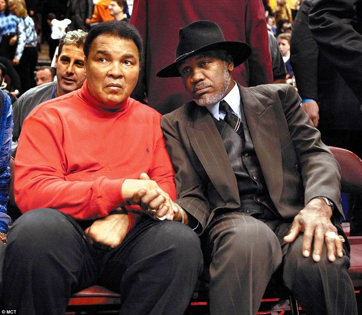 Ali shakes hands with his old rival Joe Frazier at a basketball match in Philadelphia in 2004