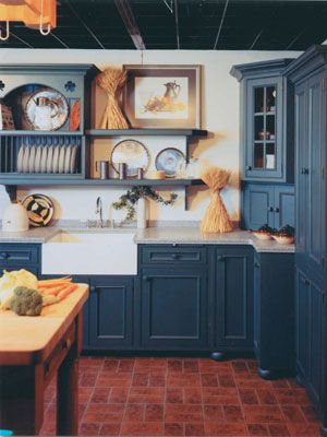 Colonial-Style Kitchens | This dream kitchen has lots of open shelf space, a country sink, and ...