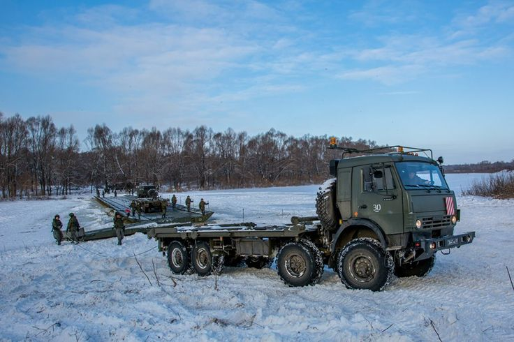 Russian military engineering troops laying out pontoon across the Oka River on January 21, 2017
