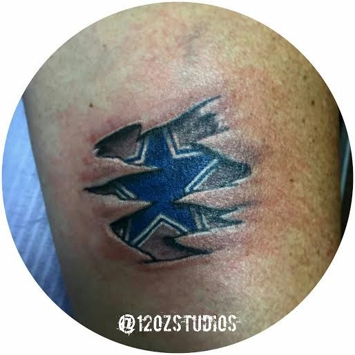 Dallas Cowboys star skin rip tattoo by Jose Bolorin.  #12ozstudios #team12oz #tattoos #tattooartist #dallas #cowboys #texas #football #nfl #tattoosformen #tattoosforwomen
