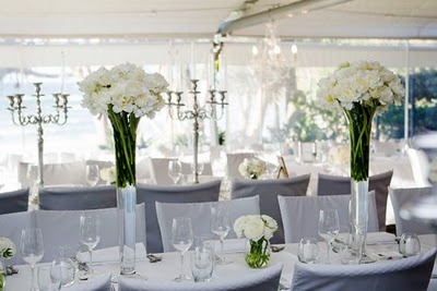 Sails Restaurant Noosa - tall flower decorations on tables www.noosaviplimousines.com airport transfers to your accommodation, wedding, restaurant