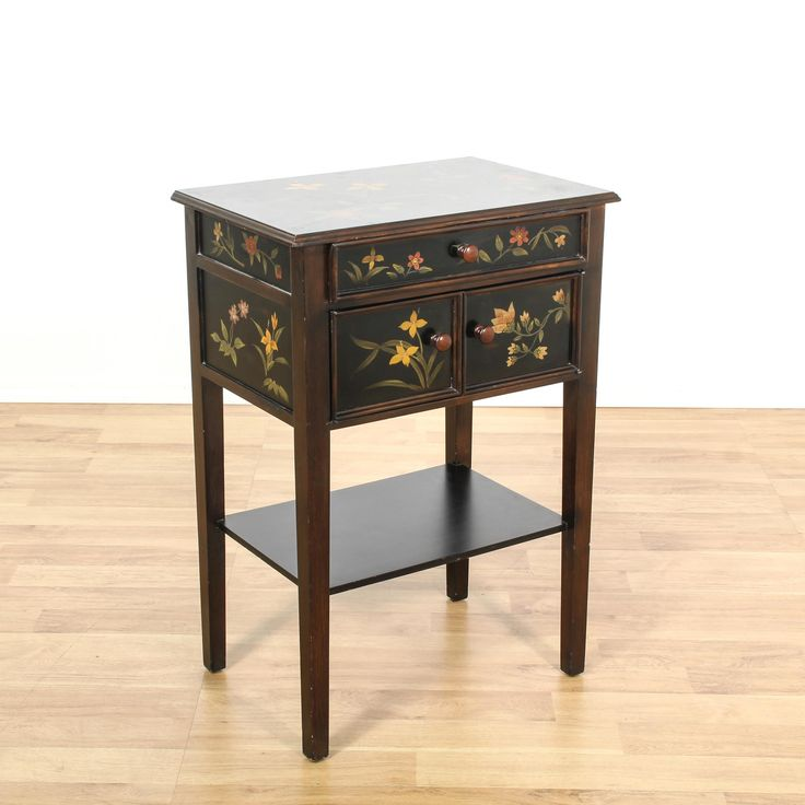 This asian inspired end table cabinet is featured in a solid wood with a glossy dark brown and black finish with floral painted accents. This side table has 1 drawer, a small cabinet and bottom tier shelf. Perfect console table for a small space! #asian #storage #cabinet #sandiegovintage #vintagefurniture