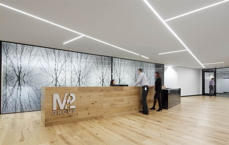 M2 Telecommunications - Main reception area Inspiration privacy decal and wooden interior to provide warmth. Melbourne, Australia