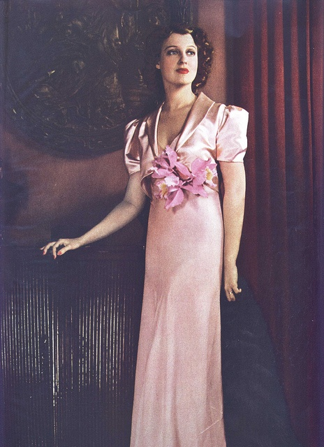 Jeanette in a frost pink evening ensemble from her own wardrobe.