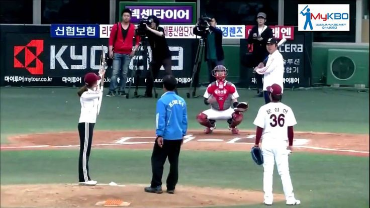 Archer Ki Bo-bae shoots a ball and arrow as her first pitch [2011]
