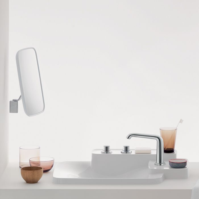 The Bouroullec Cosmetic Mirror has a clean and contemporary look that attaches to the wall. http://www.ybath.com/blog/friday-favorites-modern-makeup-mirrors/