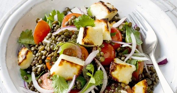 A hearty, nutritious, salad that can satisfy a healthy appetite and be assembled very quickly. Tender Puy lentils and squeaky, golden, halloumi are served with a salad of tomatoes, red onion and lemon juice.