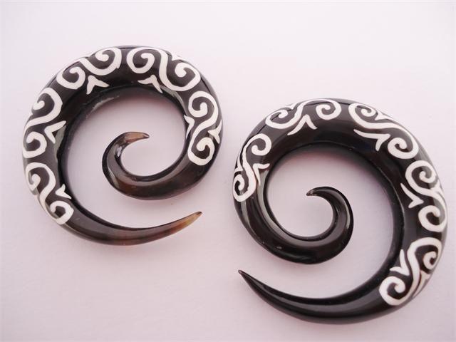 http://www.kingsbodyjewelry.com/tribalhornspirals.aspx