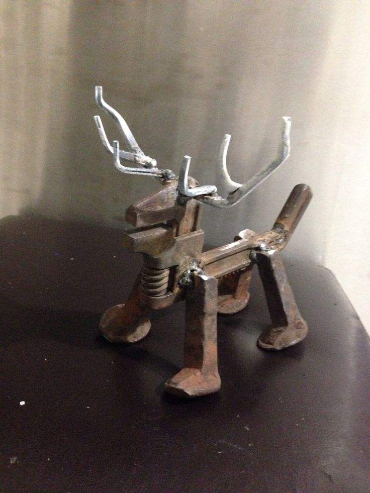 Pipe wrench and railroad spike deer.