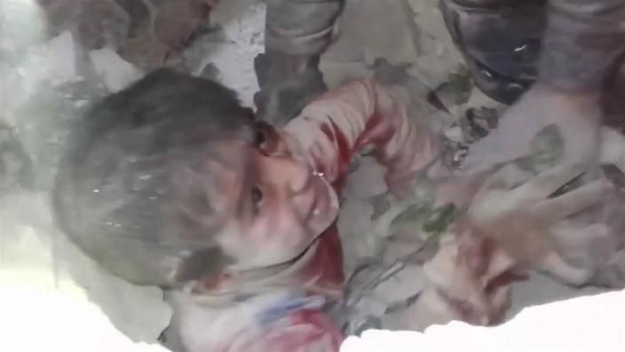 aleppo death | Six-year-old boy pulled alive from Aleppo rubble | SBS News