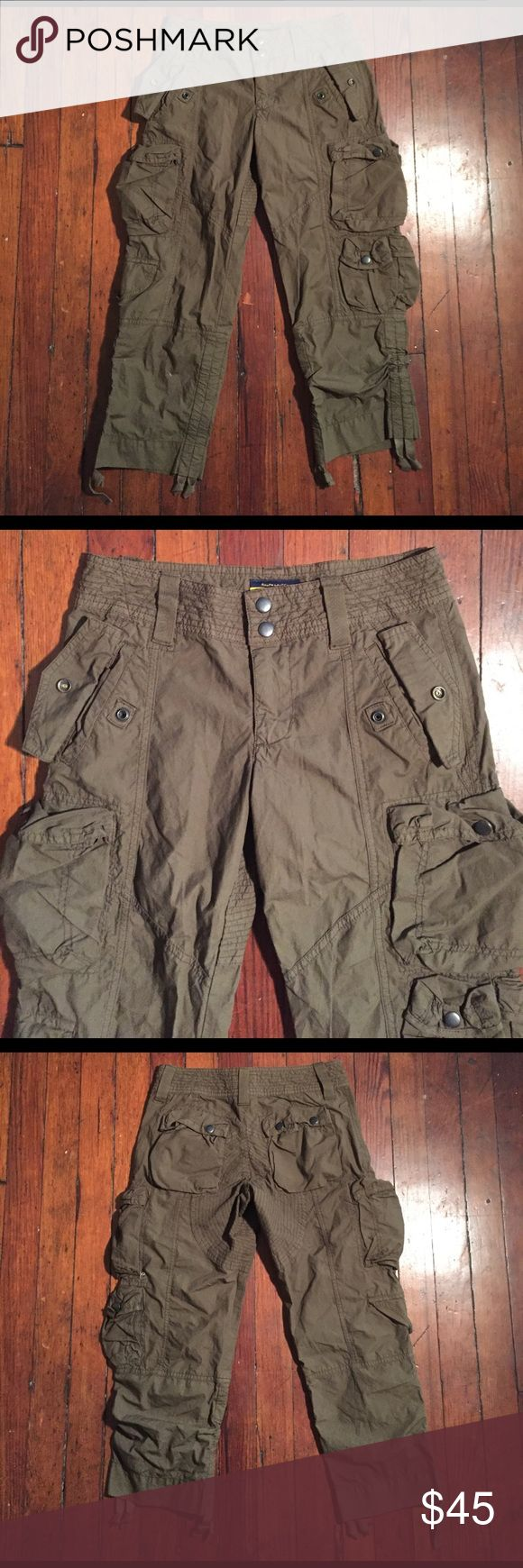 """RALPH LAUREN Green Military Cargo Capri Sz 0 For your consideration is a RALPH LAUREN green military cargo capri pant Sz 0. Pants features classic details with a mod update and great stitching details. Pants is in great condition and inseam is 23"""". Message with questions and thanks for stopping by. Ralph Lauren Rugby Pants Capris"""