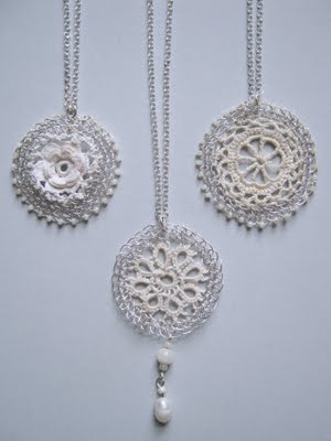 These are just beautiful.  It looks like a mixture of crochet thread and wire, plus beads.  Wow!!!