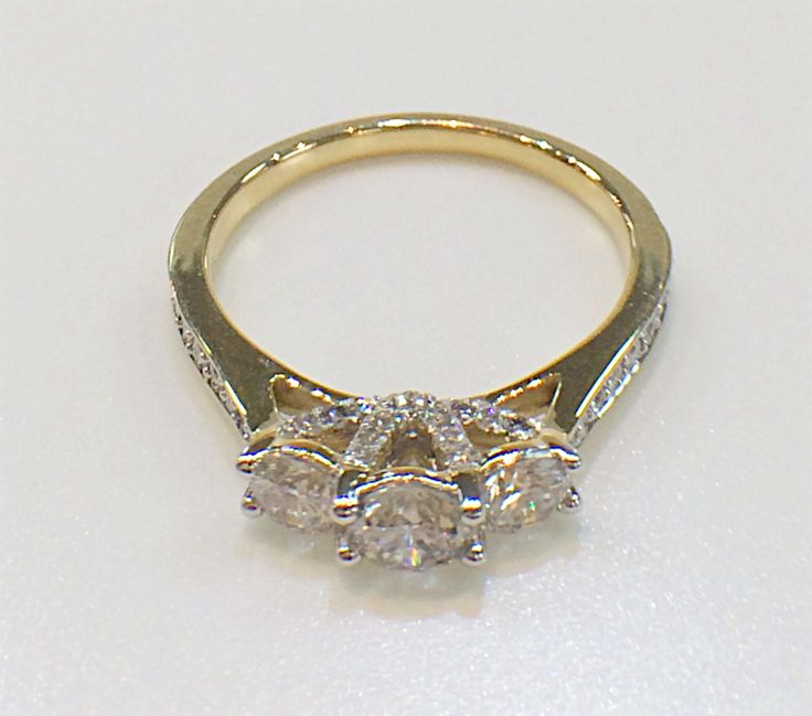 Love the detail on our pretty 3 stone diamond ring.  Side diamonds all the way!