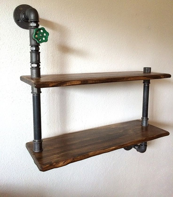 Shelf made of pipes and fittings with dimensions of 60 cm width. 72 cm tall. Wood pine color rosewood. It is possible to design your own shelves. Delivery time 2 weeks. Pictured here is a shelf that I do.