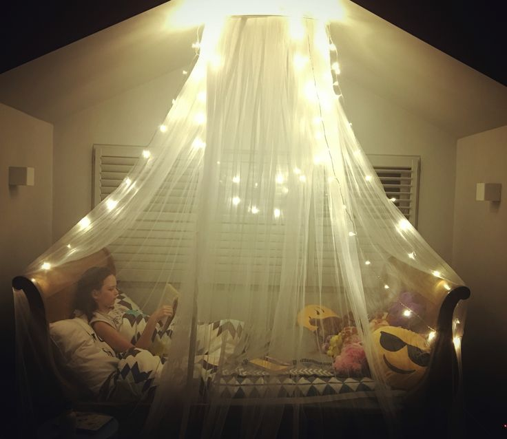 Girl bedroom - mosquito net and fairy lights! Super easy to do :-)