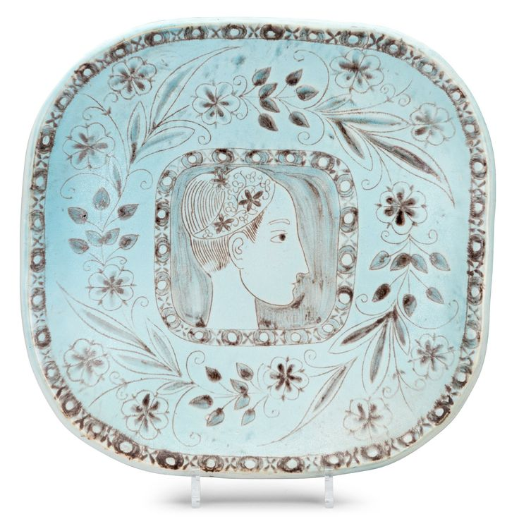 BIRGER KAIPIAINEN, A CERAMIC DISH. Signed BK, Arabia Finland. Decoration with garland and female profile. 1940s. 34.5 x 35 cm