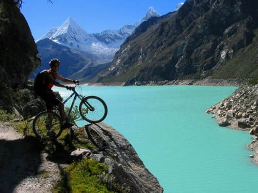 """Downhill #MTB ride in #Peru """"The Paron trails offer everything from easy winding dirt roads to kilometers of intermediate slick rock. The scenery starts at the lake area, surrounded by beautiful snow peaks, waterfalls and towering cliffs raising more than 800 m above valley's floor. You descend nearly 2000 m vertical!"""" See Pony's Peru Expeditions for more: http://www.ponyexpeditions.com/downhill_paron_lake.html"""