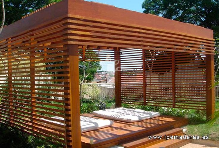 Some uniform side slats could work as well on the water tank pergola ... to prevent direct sun