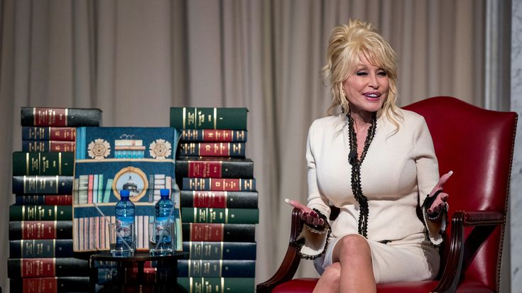 Dolly Parton visited the Library of Congress on Tuesday to celebrate a major milestone in the Imagination Library's history: delivery of its 100 millionth book to children.