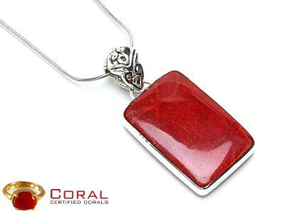 Make a striking statement with this alluring coral sterling silver pendant