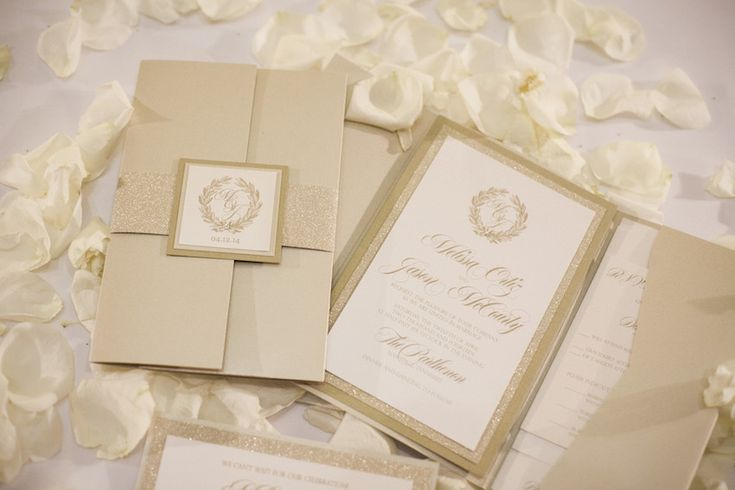 The sophisticated wedding invitation for NFL Tennessee Titans player Jason McCourty introduced the gold, ivory, and cream palette of the celebration, as well as the couple's monogram. #weddinginvitation Photography: McLellan Style. Read More: http://www.insideweddings.com/weddings/nfl-tennessee-titans-players-gold-white-wedding-in-nashville-tn/652/
