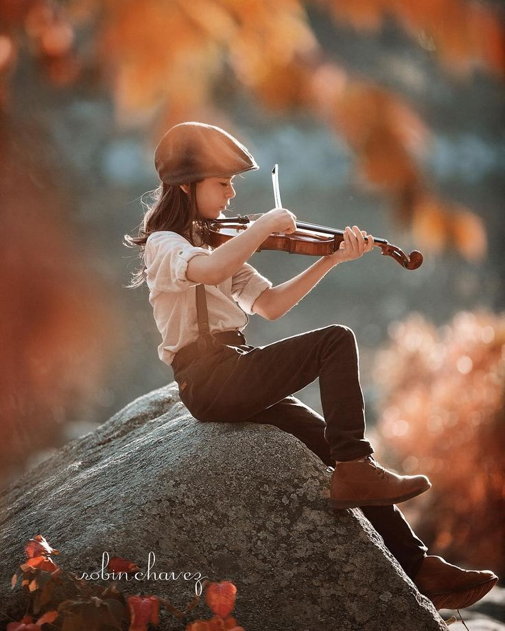 "PotD: February 16, 2016 Title: Autumn Song  Photographer: Robin Chavez — ""This image was taken of my son near our local river while he played the violin. I envisioned the image because the sounds of the violin complimented the autumn season so nicely. It was taken in natural light just after sunrise."""