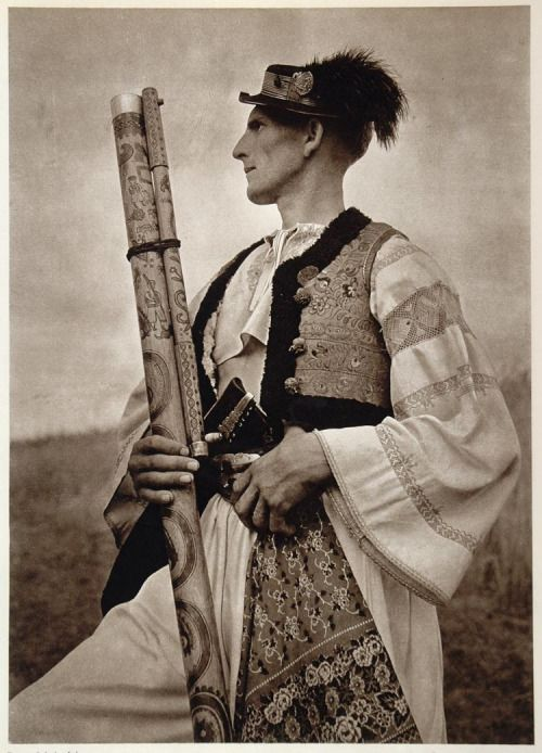 Vintage photo of a Carpathian shepherd from Slovakia with his fujara, a traditional woodwind instrument of the region.