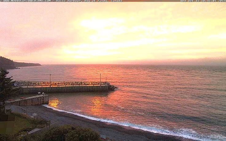 Beautiful pink & yellow colored sunset at Halls Harbour on Wednesday, October 14, 2014.  http://www.novascotiawebcams.com/en/webcams/halls-harbour-2/  #NovaScotia