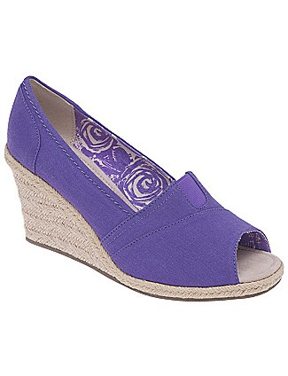 Purple Tom Wedges. They probably weren't Tom's, but when i was little.....my mom wore these all the time and in every color!!! It is true that fashion always comes back around!!!
