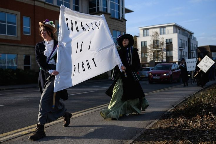 What 100 Years of British Women's Suffrage Says About Women's Rights Today: Students recreate a suffragette protest march through the town center at Royal Holloway, University of London on Feb. 6, 2018 in Egham, England. Leon Neal—Getty Images