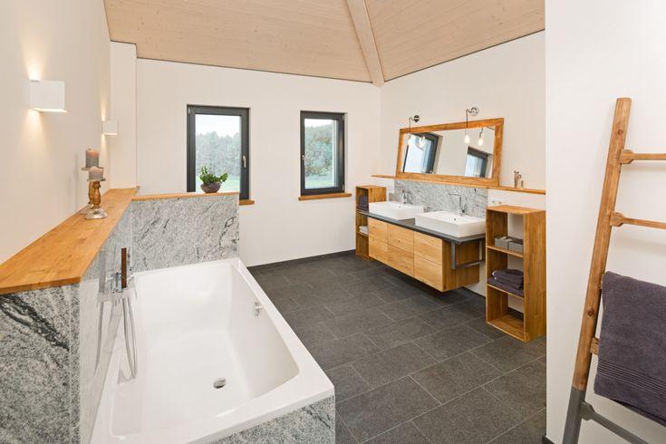 Badezimmer mit Naturstein Fliesen – Einrichtungsideen Haus Bongart von Baufritz …