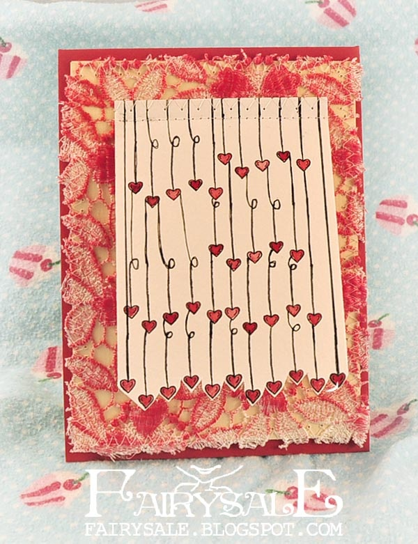This cutesy handmade wedding card is translated from German so instructions are a bit sketchy, but you get the general idea.  This card uses color on fabric, a simple heart stamp repeated many times, and a surprise under the top cover!