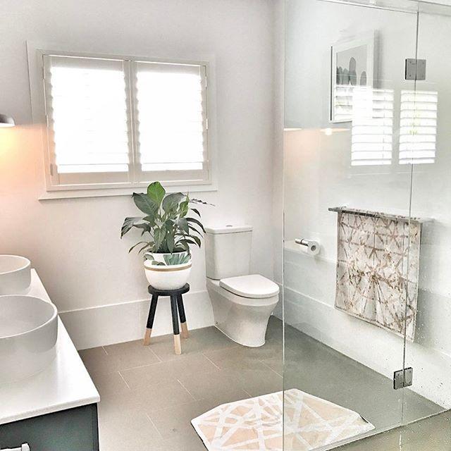 Modern bathroom design  Plantation Shutter  Matte grey floor tiles  Frameless Shower screen  Charcoal double sink vanity  Timeless, stylish design 👌