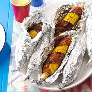 Bacon-Wrapped Corn ~ microwave bacon a bit first, wrap around husked corn, sprinkle with chili powder, wrap in heavy foil and grill over medium for 20-25 mins.