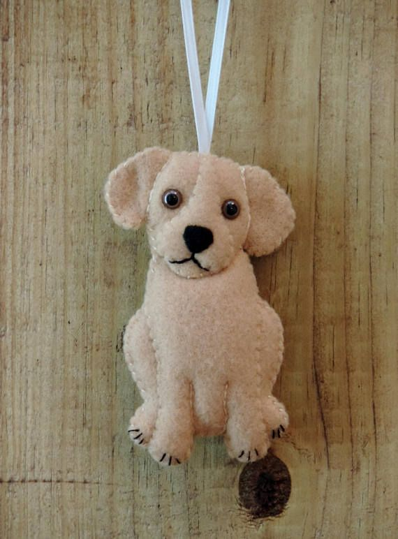Handmade little lab puppy felt ornament. Choose from chocolate, yellow, white or black Labrador puppy. The puppys head is slightly tilted to show that puppy cuteness and curiosity. All the pups have brown plastic animal eyes and black felt noses. Their mouths and toe separation is black