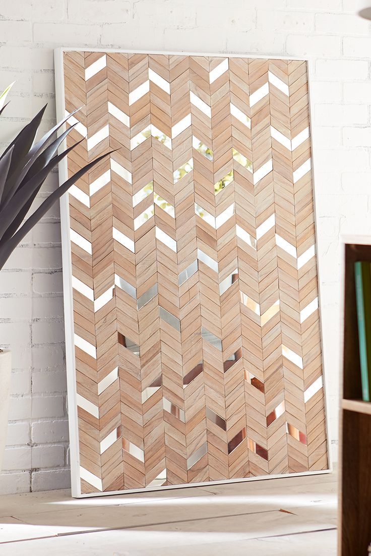 They say that fortune favors the bold, and we tend to agree. Just look at Pier 1's Metro Mirrored Wall Panel. Handcrafted and hand-painted by Indonesian artisans, it boasts a bold chevron pattern of wooden zigs and mirrored zags. All of this and it doesn't cost a fortune.