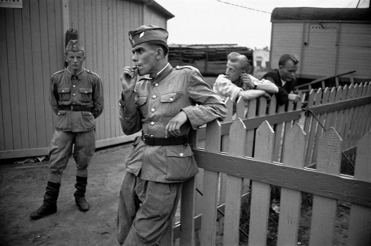 Two soldiers of the Polish People's Army relaxing on a Saturday afternoon at a fairground in Nowa Huta, 1956.
