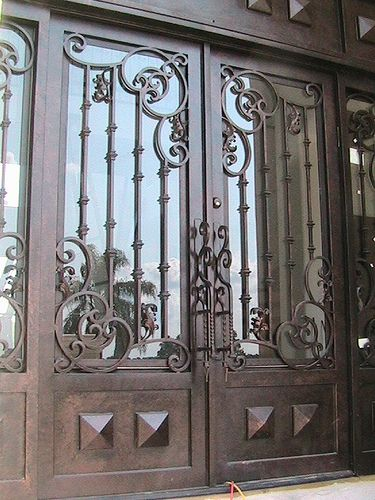 artictic wrought iron designs | Wrought iron door with insulated aquatex glass by Forge Iron Designs ...